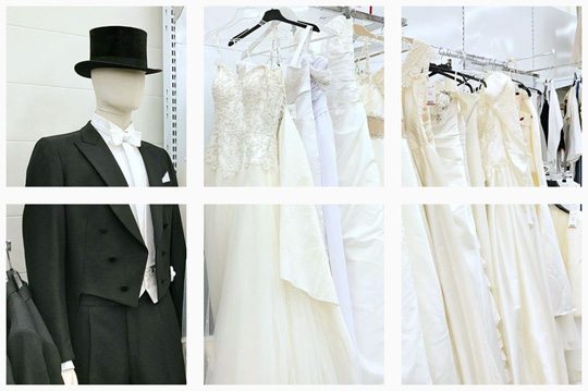 Mallinukke sulhasen puvussa ja vaaterekissä valkoisia morsiuspukuja